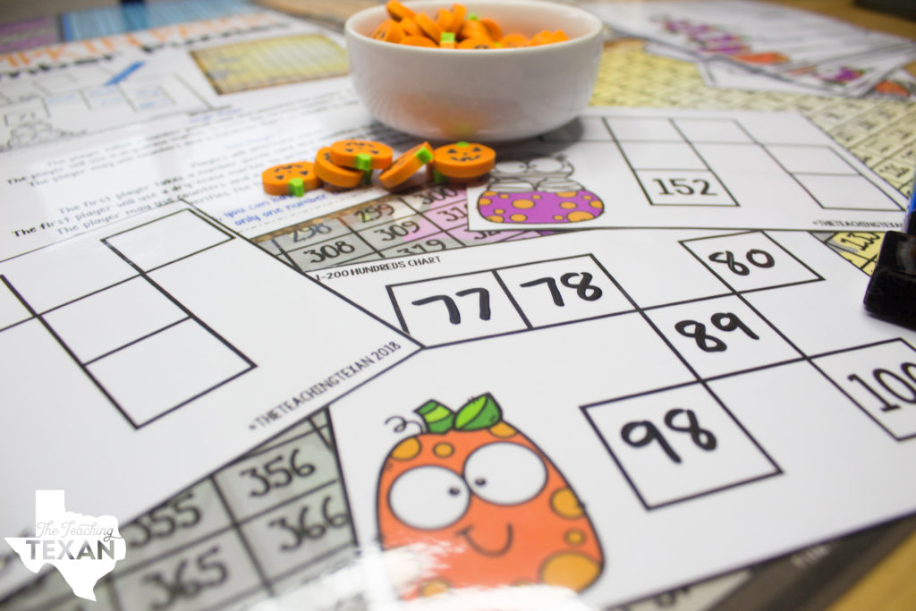 One of my favorite ways to incorporate the Halloween season is during our math block. I've loved our math curriculum, but definitely feel it is lacking in the game area so I created some Halloween-inspired games that not only hit the standards, but the kids also LOVE playing
